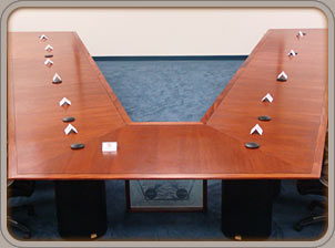 custom Honduran mahogany video conferencing table